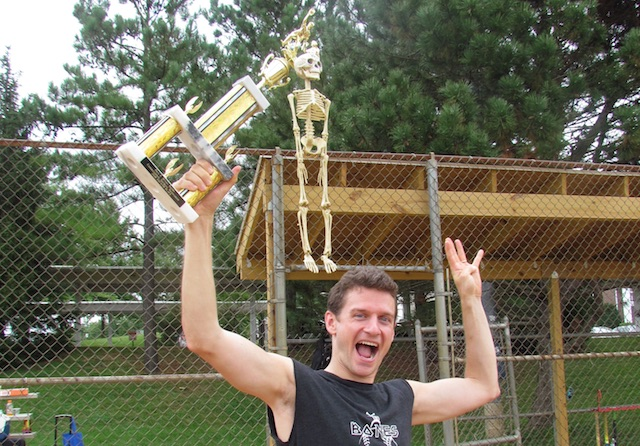 The Bones Brigade skeleton mascot latches onto their trophy